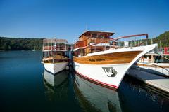 Skradin, croatia - jul 28: tourist boats anchored in krka river on july 28 Stock Photos