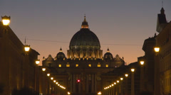 San Pietro church dome Via della Conciliazione Vatican city dusk orange sky Rome Stock Footage