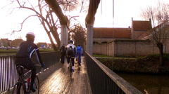 Cyclists on the canal bridge Brugge. Stock Footage