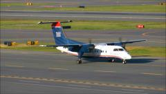 Prop plane taxies on runway Stock Footage