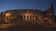 Great Colosseum forum ancient Rome landmark twilight sunset dusk traffic night Stock Footage