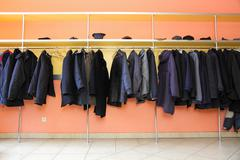 Many clothes in cloakroom Stock Photos