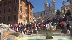 Piazza Spagna Spanish Steps climb Rome stairway square Trinità dei Monti church Stock Footage