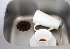 Dishwashing. white dishes in the kitchen sink. Stock Photos
