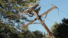 Severely Leaning, Damaged Power Pole Stock Footage