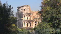 Great Colosseum forum among tree iconic monument old arena history travel Rome  Stock Footage