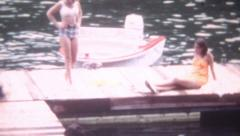 8mm Vintage Film 1968 Teenage Girls Bathing Suits Lake Boat Dock Vacation Sun  Stock Footage