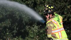 Male & Female Firefighter Team Fights Brush Fire #7 Stock Footage
