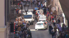 Aerial view crowded busy narrow street people shop old town city traffic Rome - stock footage