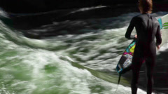 "Surfing on the river ""Сold creek"" in the English Garden Stock Footage"
