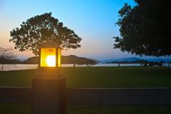 Lighting pole and sunset at camping ground Stock Photos