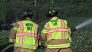 Stock Video Footage of Male & Female Firefighter Team Fights Brush Fire #4