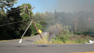 Stock Video Footage of Brush Fire, Leaning Power Pole, Fallen Street Light