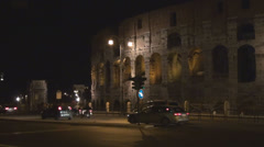 Arch Constantine Great Colosseum forum arena night nightlife Rome Italy traffic  Stock Footage