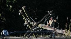 Fallen Power Pole & Street Lamp Stock Footage
