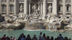 Trevi Fountain Fontana di Trevi statue facade Rome water throwing coin people Stock Footage
