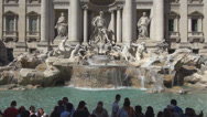 Stock Video Footage of Trevi Fountain Fontana di Trevi statue facade flowing water throwing coin people