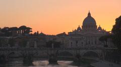 San Pietro church dome Rome Vittorio Emanuele II bridge River Tiber twilight  Stock Footage