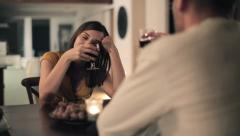 Drunk couple talking and drinking by the table at home HD Stock Footage