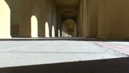 Stock Video Footage of Spanish Style Cloister Passageway with Shadows