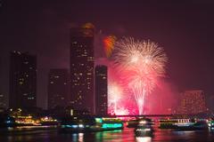 firework countdown at chaopraya river view bangkok thailand - stock photo