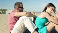 Stock Video Footage of Unhappy, sad couple sitting on the beach HD