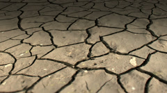 Desert mudcracks from drought dolly shot Stock Footage