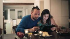 Couple doing online shopping with tablet computer by the table HD Stock Footage