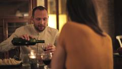 Young couple talking and drinking wine by the table at home HD - stock footage