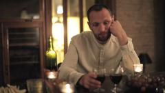 Sad man waiting for someone late at night by the table HD Stock Footage