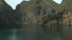 Passing cliff coast at westman islands in iceland Stock Footage