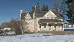 Historic pioneer stone home winter pan HD 0028 Stock Footage