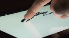Drawing With Finger Touchscreen iPad Stock Footage