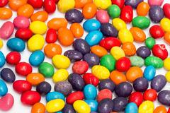 Colorful candy scattered Stock Photos