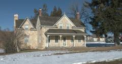 Historic pioneer stone home winter pan original 4K 0028 Stock Footage
