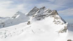 Swiss Alpine Alps mountain landscape. Viewed from Jungfraujoch Stock Footage