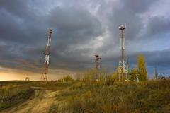 phone towers against the evening sky - stock photo
