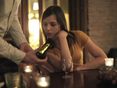 Elegant woman in restaurant gets wine from waiter NTSC Stock Footage