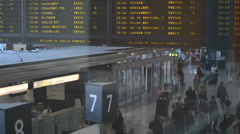 Airport departures board with people - stock footage