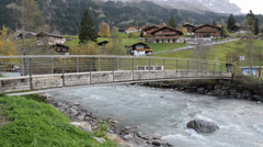 River flows over rocks in this beautiful scene in the swiss Alps Stock Footage