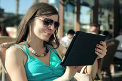 Happy beautiful woman with tablet computer sitting in cafe NTSC - stock footage