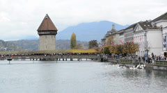 Panoramic view of wooden Chapel bridge and old town of Lucerne, Switzerland Stock Footage