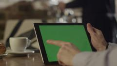 Man using Tablet in Coffee Shop 1 Stock Footage