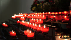 Lots of red church candles - stock footage