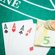 Four aces and euros Stock Photos