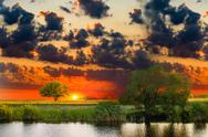 Stock Photo of sunset river sky summer tree landscape nature forest reflection