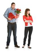 valentine: woman annoyed with valentine's gifts - stock photo