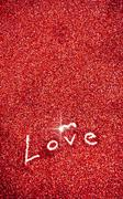 Glitter: love written in red glitter background Stock Photos
