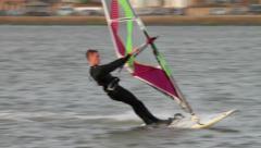 male windsurfer sails on lake - stock footage
