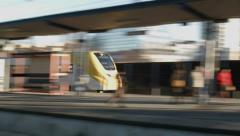 Motion blurred fast commuter train Stock Footage